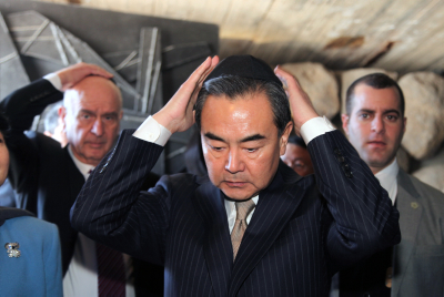 Chinese Foreign Minister Wang Yi seen during a visit at the Yad Vashem Holocaust memorial in Jerusalem, 19 December 2013. Photo by Issac Harari/Flash90