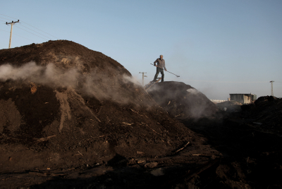 Palestinian workers extract charcoal from sand at the production facility, east of the Jabaliya refugee camp, northern Gaza City, Gaza Strip March 21, 2014. Photo by emad nassar/FLASH90