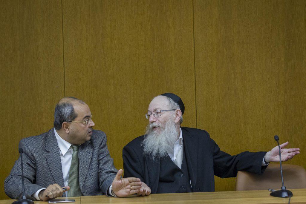 Arab parliament member Ra'am- Ta'al Achmad Tibi (L) seen with United Torah Judaism parliament member Yaakov Litzman during a meeting of the Israeli opposition, in the Israeli parliament on November 03, 2014. Photo by Miriam Alster/FLASH90 *** Local Caption *** ëðñú àåôåæéöéä èéáé àçîã øò''í úò''ì çøãé éäåãé éò÷á ìéöîï