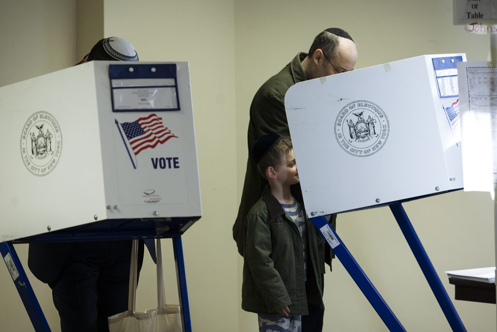 Voters cast ballots at a polling station in New York. (Amir Levy/Flash90)