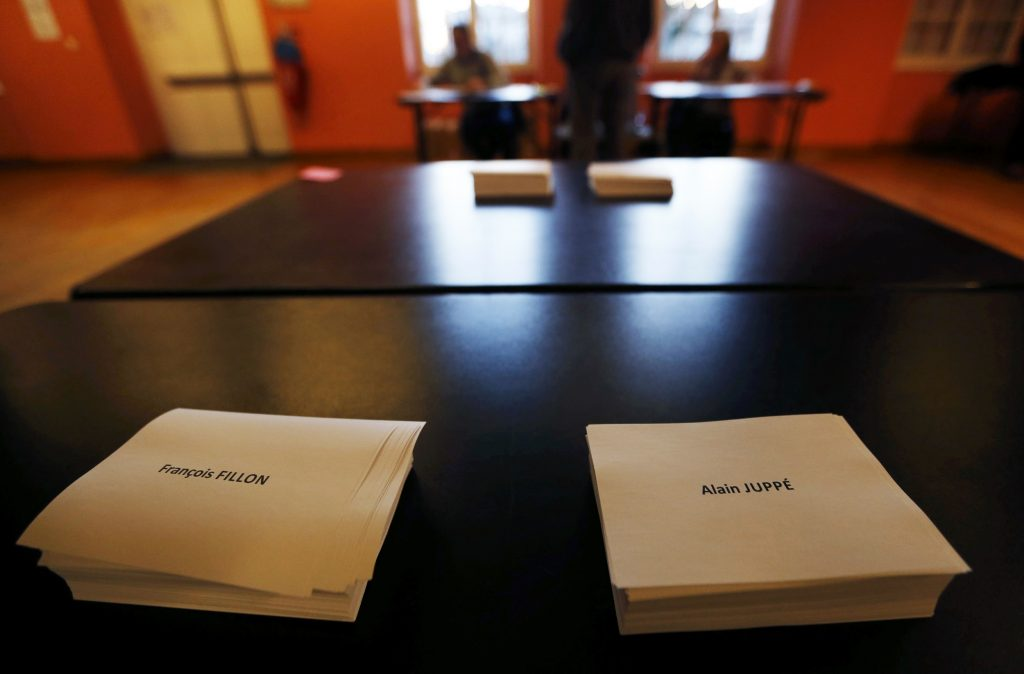 Ballots with the names of Alain Juppe and Francois Fillon, members of the conservative Les Republicains political party, are seen at a polling station during the second round of the French center-right presidential primary election in Bordeaux, France, November 27, 2016. REUTERS/Regis Duvignau