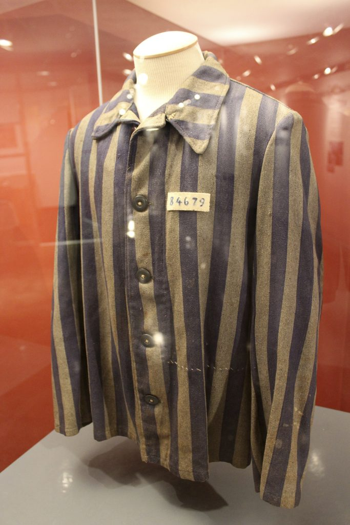 The concentration camp uniform once worn by Ben Peres hangs in the Kuperferberg Holocaust Center at Queensborough Community College. (AP Photo/Frank Eltman)