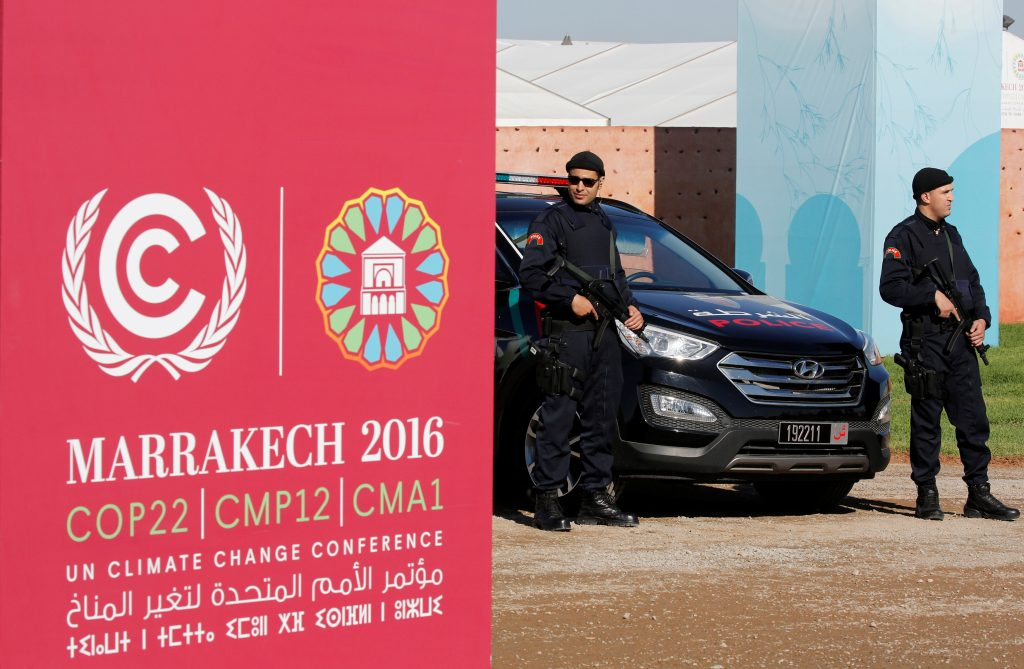 Moroccan security guards in front of the entrance of the World Climate Change Conference 2016 (COP22) in Marrakech, Morocco, this week. (Youssef Boudlal/Reuters)