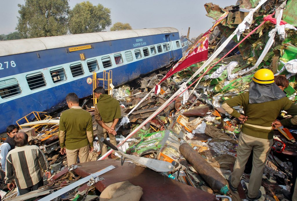 Rescue workers search for survivors at the site of a train derailment in Pukhrayan, south of Kanpur city, India November 20, 2016. REUTERS/Jitendra Prakash