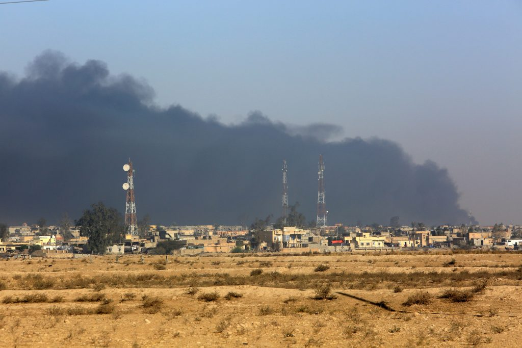 Smoke rises from oil wells, set ablaze by Islamic State militants before fleeing the oil-producing region of Qayyara, Iraq, November 12, 2016. REUTERS/Air Jalal