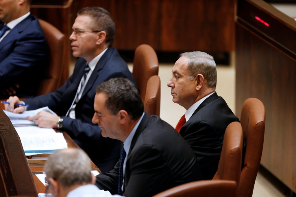 Prime Minister Binyamin Netanyahu (R) attends a preliminary vote on a the Settlements Arrangement bill at the Knesset, Wednesday. (Reuters/Ammar Awad)