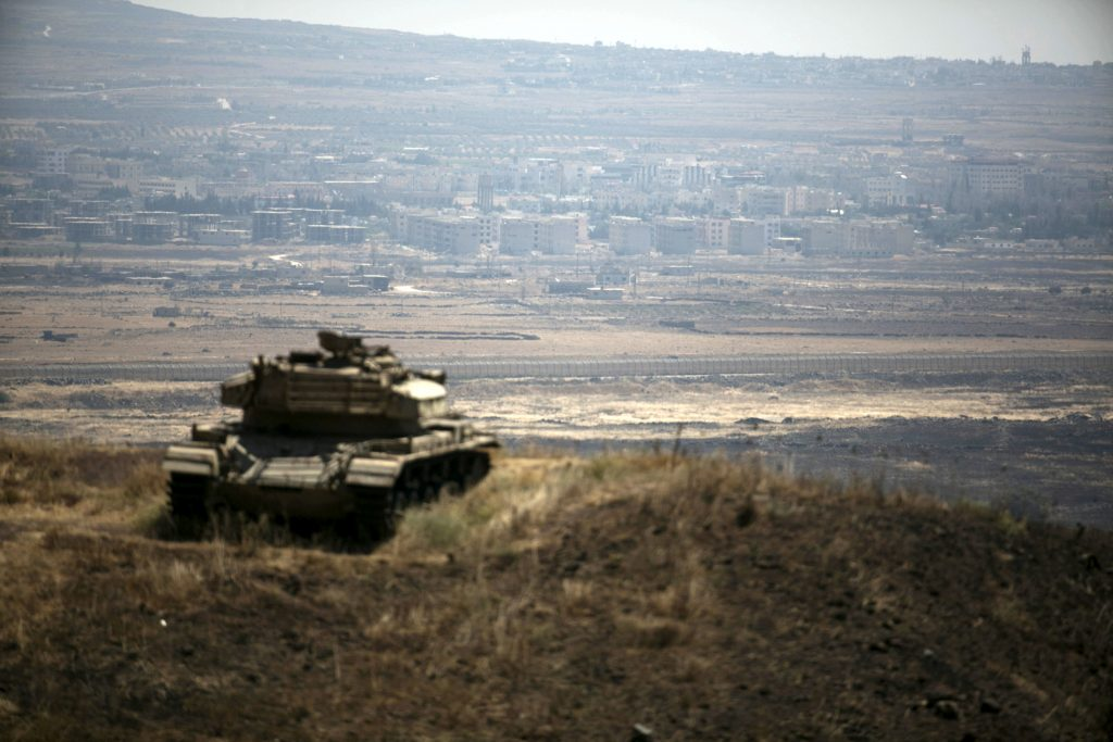 FILE PHOTO: The Syrian area of Quneitra is seen in the background as an out-of-commission Israeli tank parks on a hill, near the ceasefire line between Israel and Syria, in the Israeli-occupied Golan Heights, August 21, 2015. REUTERS/Baz Ratner/File Photo