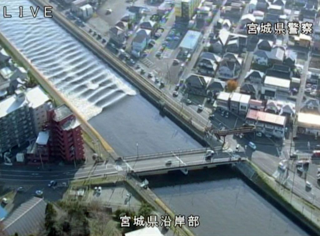 A tidal surge is seen in Sunaoshi River after tsunami advisories were issued following an earthquake in Tagajo, Miyagi prefecture, Japan November 22, 2016, in this video grab image released by Miyagi Prefectural Police via Kyodo. Mandatory credit Miyagi Prefectural Police/Kyodo/via REUTERSATTENTION EDITORS - THIS IMAGE WAS PROVIDED BY A THIRD PARTY. EDITORIAL USE ONLY. MANDATORY CREDIT. JAPAN OUT. NO COMMERCIAL OR EDITORIAL SALES IN JAPAN. TPX IMAGES OF THE DAY
