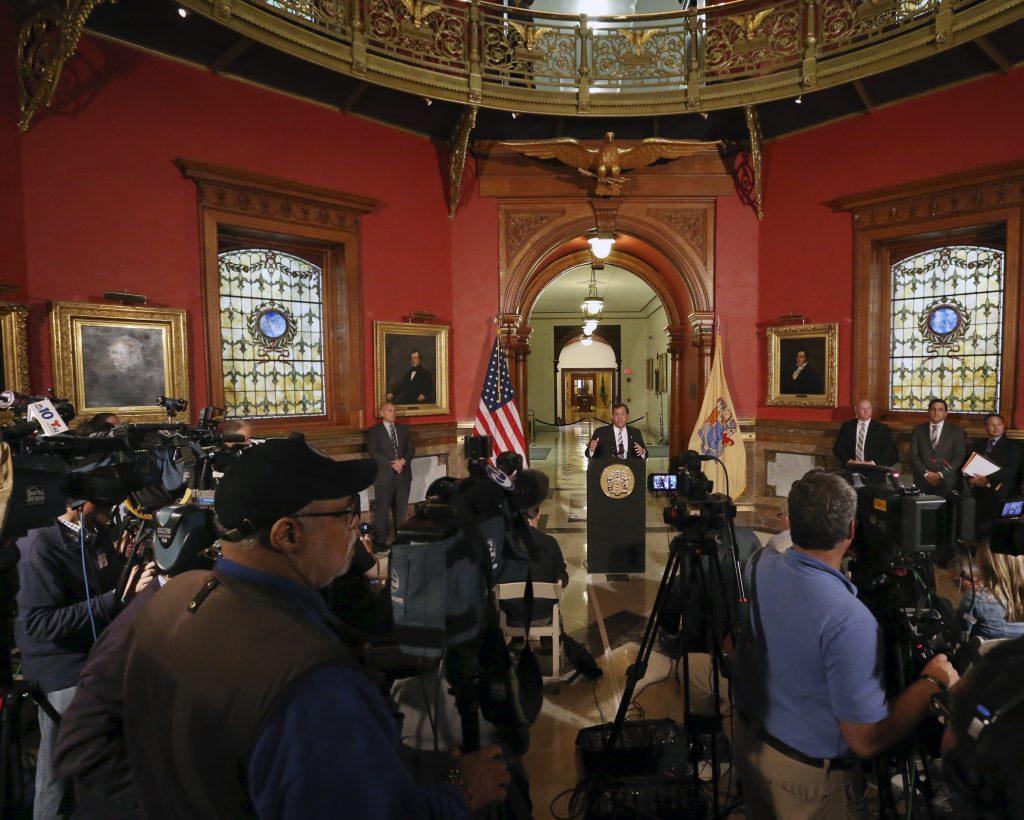 New Jersey Gov. Chris Christie on Tuesday addresses a gathering in the Statehouse rotunda. (AP Photo/Mel Evans)