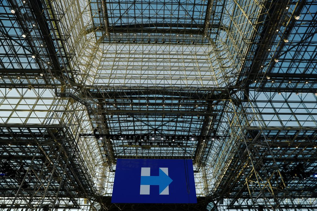A screen displaying the logo of Hillary Clinton's campaign hangs underneath the glass ceiling of Jacob K. Javits Convention Center, which will serve as the site of the Clinton campaign's election-night party. (Reuters/Lucas Jackson)