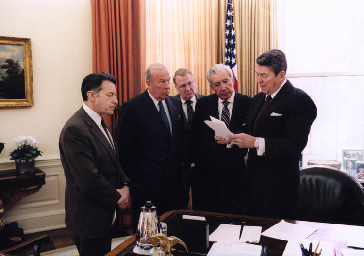 Reagan meets with (L-R) Secretary of Defense Caspar Weinberger, Secretary of State George Shultz, Attorney General Ed Meese and Chief of Staff Don Regan in the Oval Office.