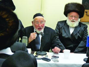 Reb Ben Zion (L) at a melaveh malkah with Reb Abish Brodt.