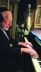 Reb Ben Zion in the recording studio.