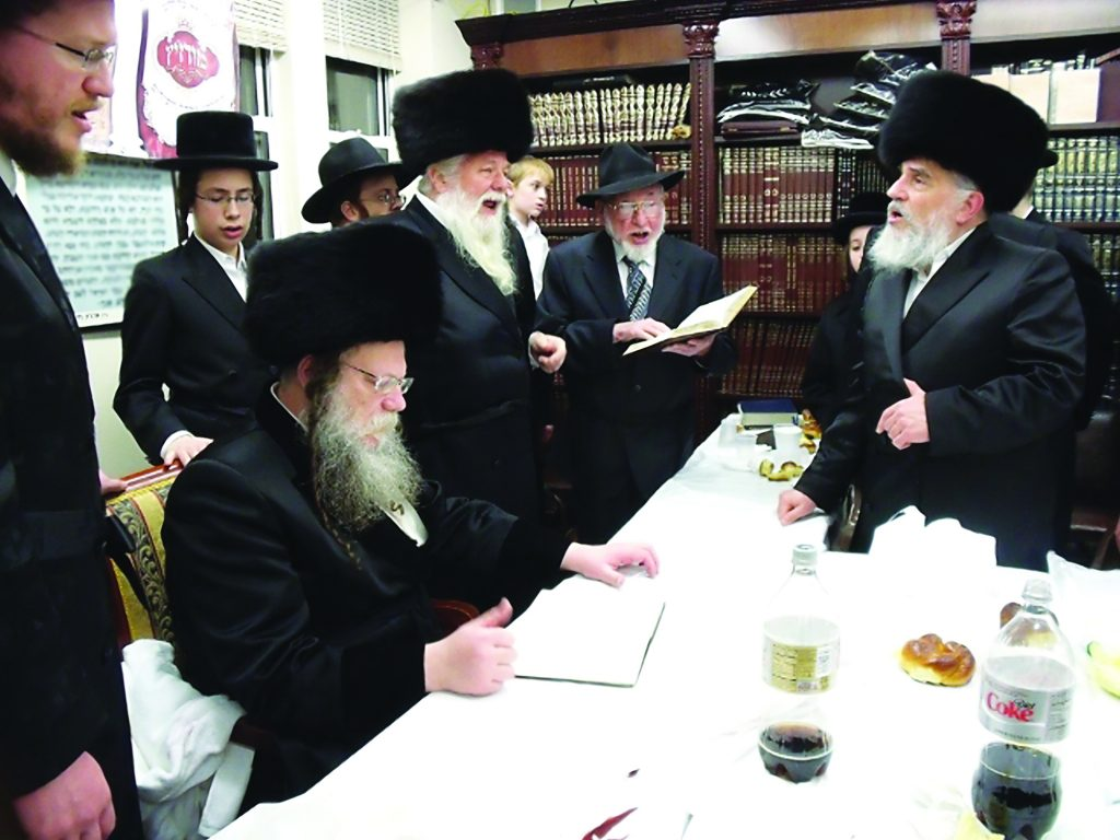Reb Ben Zion with the Modzitzer Rebbe, shlita, and Chassidim at the Modzitzer shtiebel in Brooklyn.