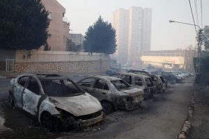 Cars burnt by fire, in the northern city of Haifa, Thursday. (Baz Ratner/Reuters)