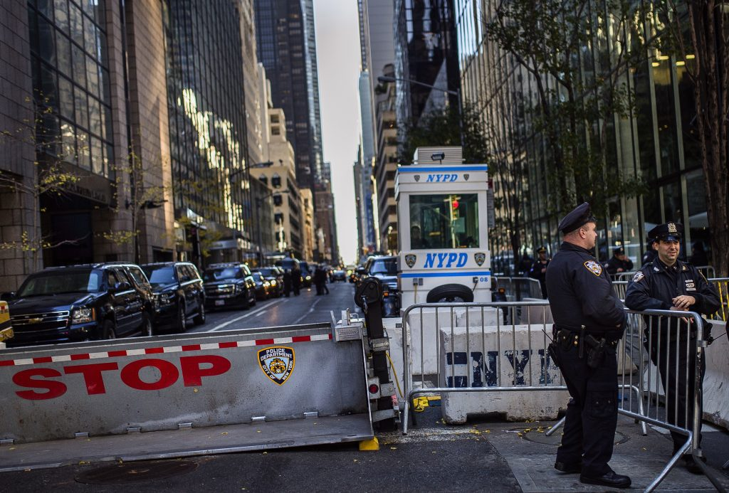 Secret Service security vehicles gather outside Trump Tower (left) on Friday. (AP Photo/Andres Kudacki)