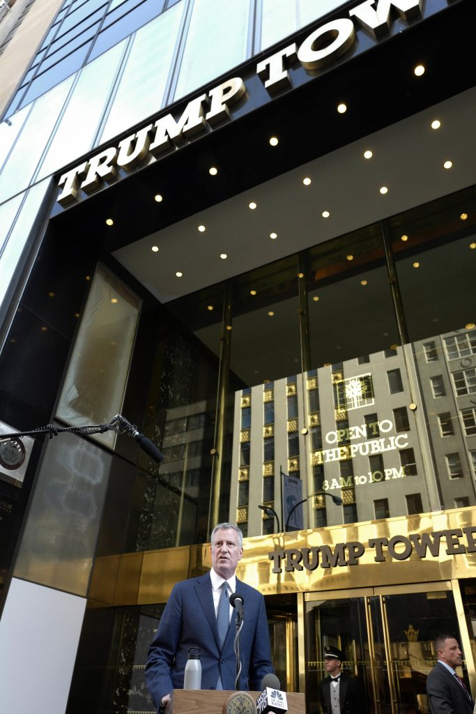 Mayor Bill de Blasio holds a news conference in front of Trump Tower Wednesday following a meeting with President-elect Donald Trump. (AP Photo/Mark Lennihan)