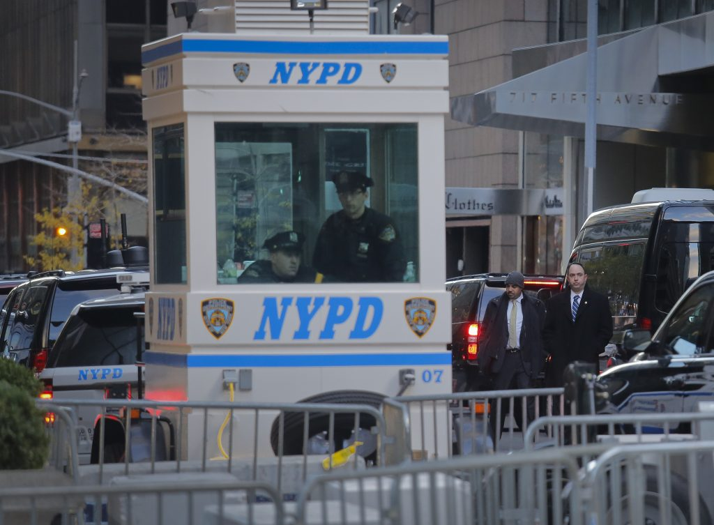 NYPD officers and Secret Service agents on Tuesday secure the street at Trump Tower. (AP Photo/Bebeto Matthews)