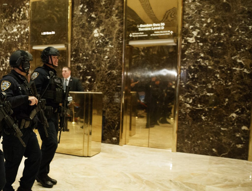 NYPD officers on Tuesday walk in the lobby of Trump Tower. (AP Photo/Evan Vucci)