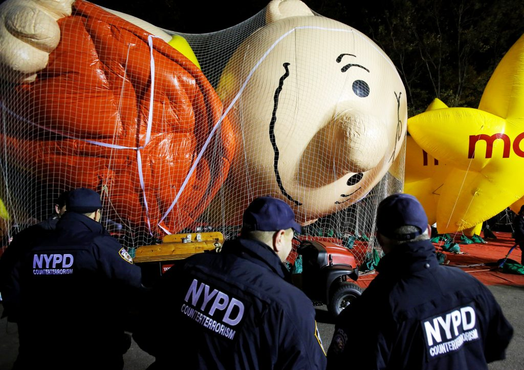 Members of the New York Police Department's Counterterrorism Bureau watch as preparations are made ahead of the 90th Macy's Thanksgiving Day Parade in Manhattan, New York, U.S., November 23, 2016. REUTERS/Andrew Kelly