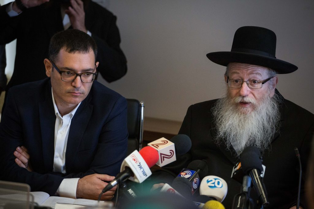 Health Minister Rabbi Yaakov Litzman and Health Ministry General Manager Moshe Bar Siman Tov at a press conference Monday to announce new markings on food products containing sugar and fat. (Hadas Parush/Flash90)