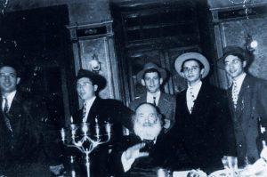 "Reb ben Zion Shenker (2nd L), dancing behind teh Modzhiter Rebbe z""ya. (Dovid Sears)"
