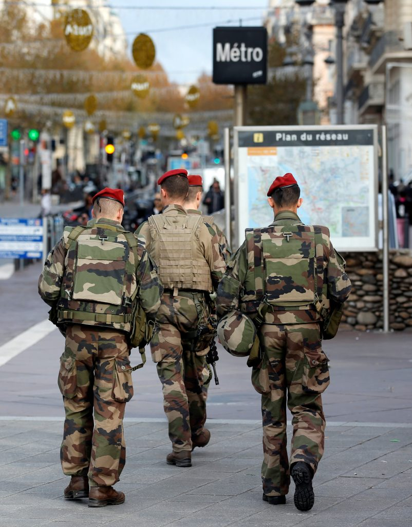 French soldiers patrol in the streets of Marseille, France, November 23, 2016. REUTERS/Jean-Paul Pelissier