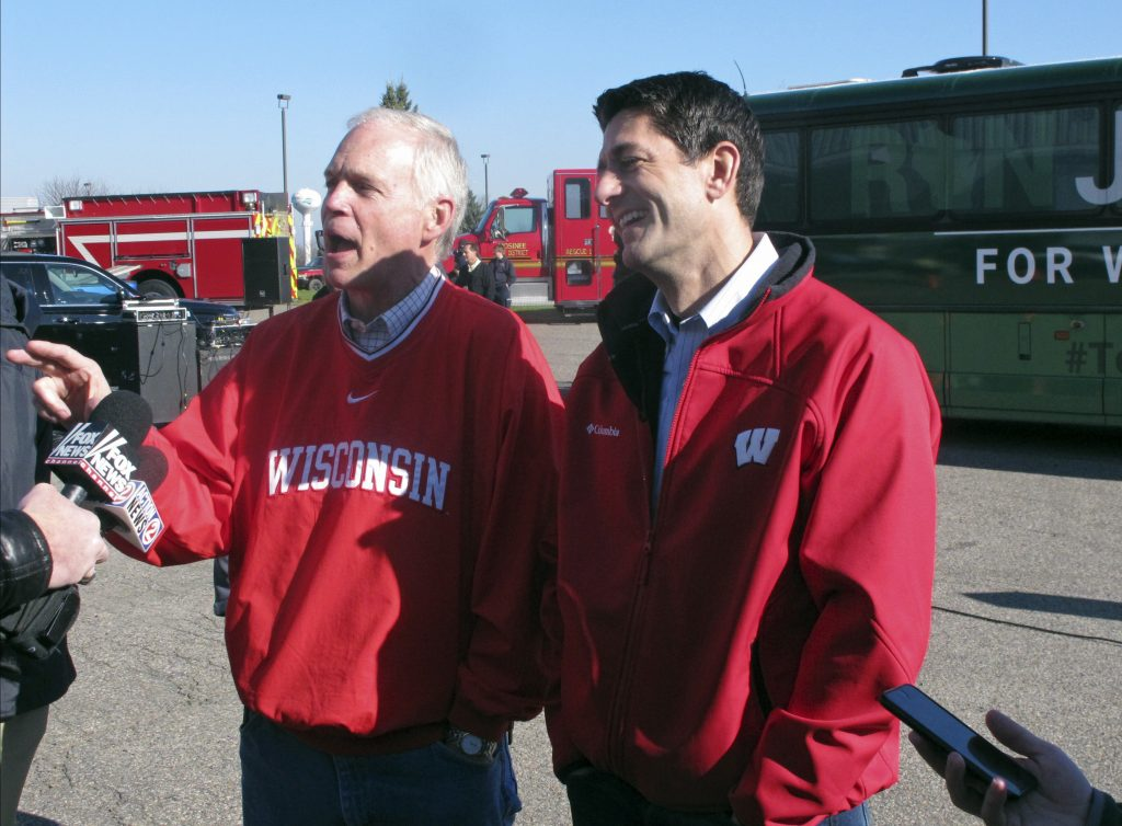 U.S. House Speaker Paul Ryan (R) and Sen. Ron Johnson, both Wisconsin Republicans, campaign together in Mosinee, Wis., on Nov. 4. (AP Photo/Scott Bauer, File)