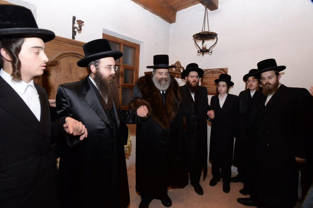 Dancing in the bais hamedresh of the Baal Shem Tov HaKadosh in Mezhmuzh. (JDN)