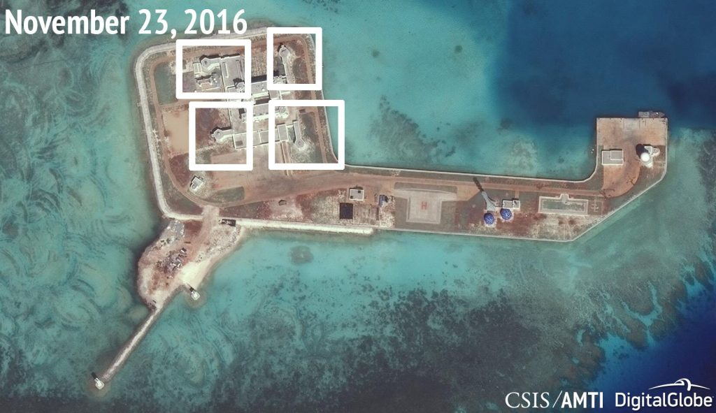 A satellite image shows what CSIS Asia Maritime Transparency Initiative says appears to be anti-aircraft guns and what are likely to be close-in weapons systems (CIWS) on the artificial island Hughes Reef in the South China Sea. (ARMS Courtesy CSIS Asia Maritime Transparency Initiative/DigitalGlobe/Handout via Reuters)