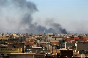 Smoke rises over Mosul, Iraq, on Tuesday. (Reuters/Ahmed Jadallah)