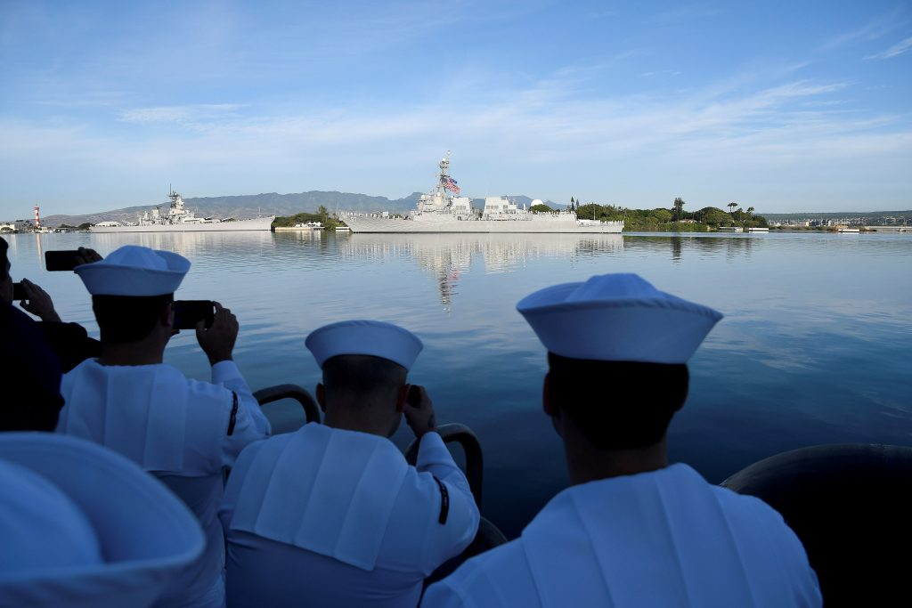 U.S. Navy sailors watch as the USS Halsey passes the USS Arizona Memorial during ceremonies on Wednesday, the 75th anniversary of the attack on Pearl Harbor. (Reuters/Hugh Gentry)