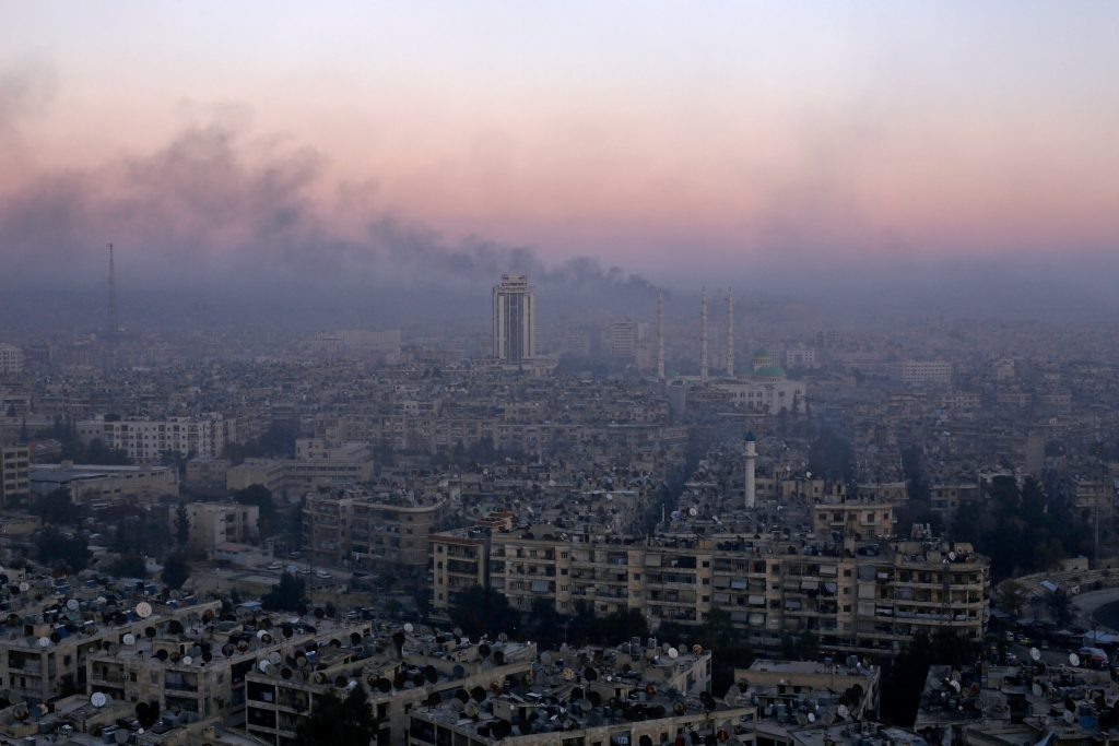 Smoke rises near the Old City of Aleppo, as seen from a government-controlled area of the city, on Thursday. (Reuters/Omar Sanadiki)