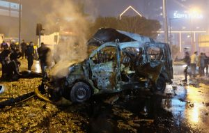 A damaged vehicle is seen after the blasts. (Reuters/Murad Sezer)