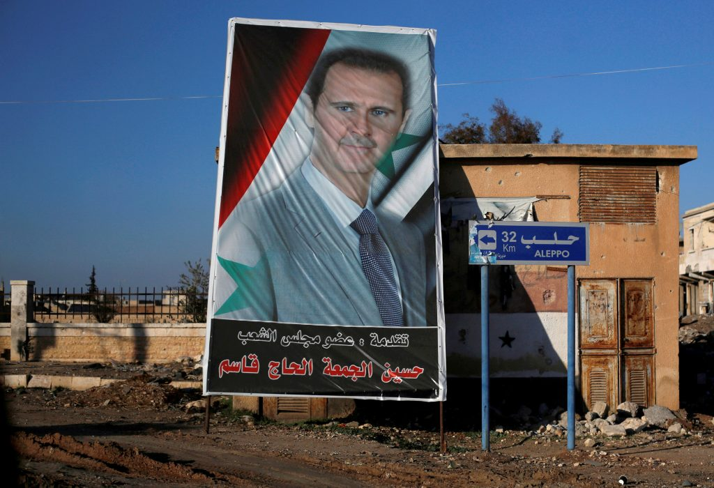 A picture of Syrian President Bashar al-Assad is seen in Ramouseh, a government-controlled area of Aleppo. (Reuters/Omar Sanadiki/File)