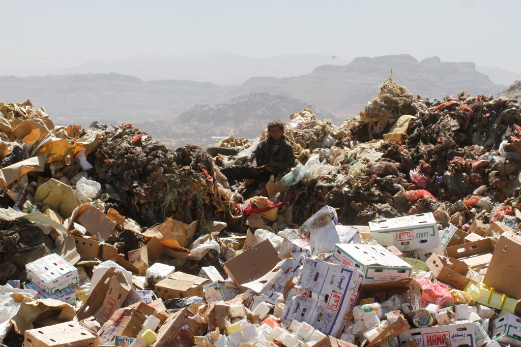 A boy sits on a pile of trash at a landfill site on the outskirts of Sanaa, Yemen, last month. (Reuters/Mohamed al-Sayaghi)