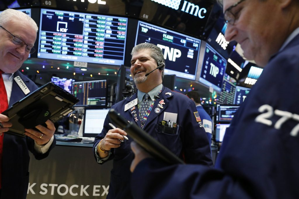 Traders laugh on  the floor of the New York Stock Exchange on Tuesday. (Reuters/Lucas Jackson)