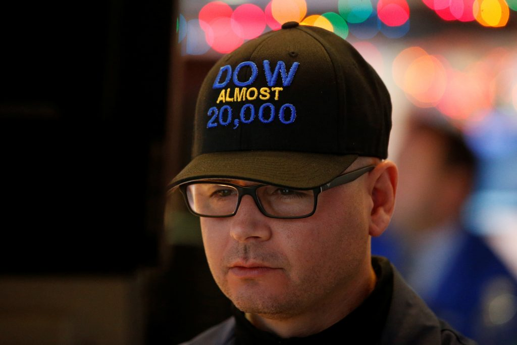 """Specialist trader Mario Picone wears a """"DOW Almost 20,000"""" cap as he works on the floor of the New York Stock Exchange on Thursday. (Reuters/Brendan McDermid)"""