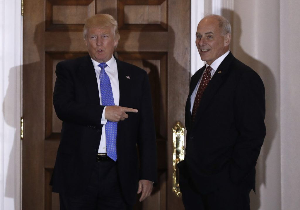 President-elect Donald Trump talks to media as he stands with retired Marine Gen. John Kelly, right, at the Trump National Golf Club Bedminster clubhouse Sunday, Nov. 20, 2016, in Bedminster, N.J.. (AP Photo/Carolyn Kaster)