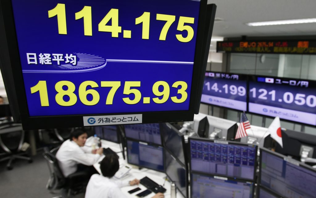 A monitor shows the current exchange rate between Japanese yen and U.S. dollar, top, and Nikkei stock index, bottom, at a foreign exchange brokerage in Tokyo Thursday, Dec. 1, 2016. Asian stock markets moved mostly higher on Thursday as upbeat factory data from China boosted investor sentiment. The dollar rose to 114.48 yen from 114.44 yen. (AP Photo/Shuji Kajiyama)