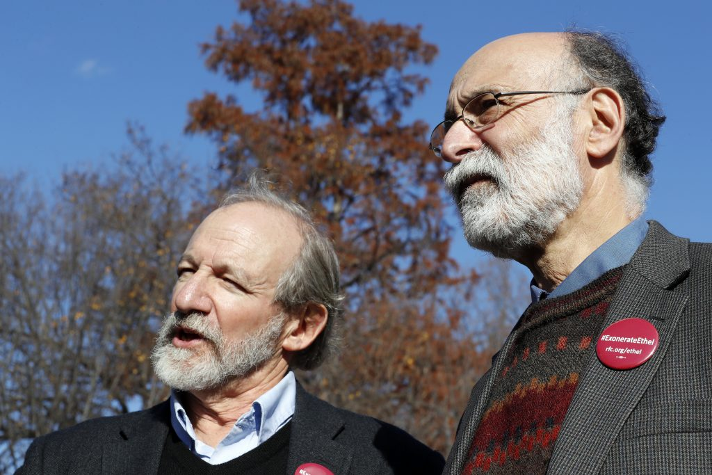 Michael (L) and Robert Meeropol speak to the media after they attempted to deliver a letter to President Barack Obama in an effort to obtain a exoneration for their mother Ethel Rosenberg, in front of the White House, on Thursday. (AP Photo/Alex Brandon)