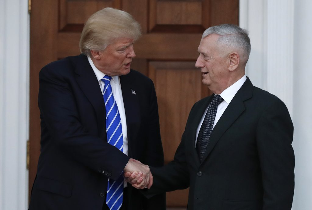 President-elect Donald Trump shakes hands with retired Marine Corps Gen. James Mattis as he leaves Trump National Golf Club Bedminster on Nov. 19. (AP Photo/Carolyn Kaster, File)