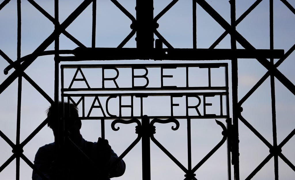 In this April 29, 2015 photo, a blacksmith prepares a replica of the stolen Dachau gate. (AP Photo/Matthias Schrader,File)