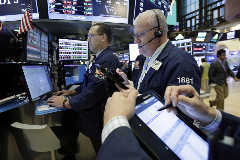Traders works on the floor of the New York Stock Exchange, Friday, Dec. 2, 2016. U.S. stocks are mixed as a rally in oil prices and bank stocks fades. (AP Photo/Richard Drew)