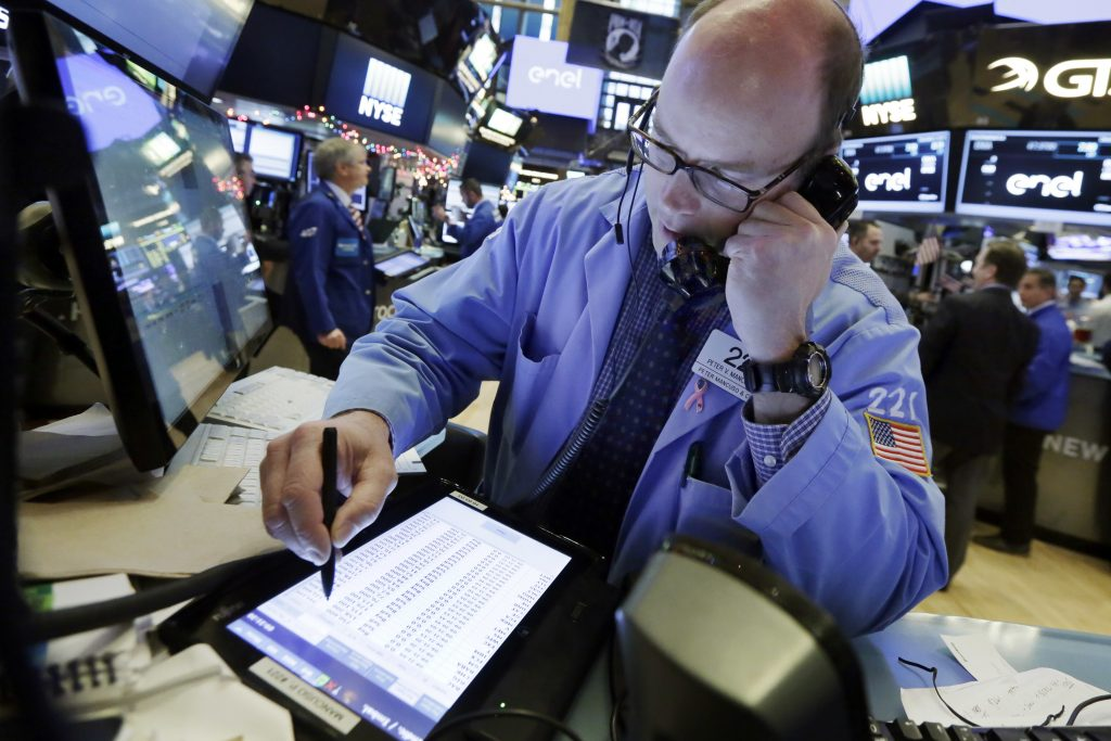 Trader Kevin Mancuso works on the floor of the New York Stock Exchange on Friday. (AP Photo/Richard Drew)