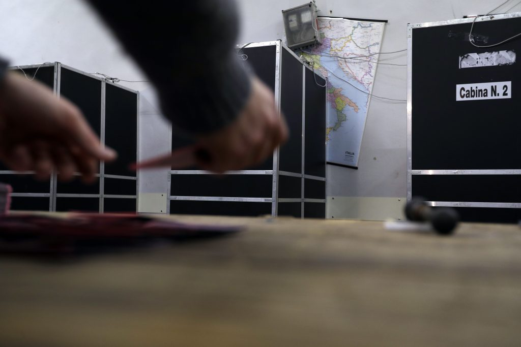 Ballots are counted at a polling station on the eve of the Constitutional Reform Referendum in Rome, Saturday, Dec. 3, 2016. A voter referendum on changes to Italy's post-war Constitution scheduled for Sunday has turned into a virtual plebiscite on Premier Matteo Renzi's center-left government. (AP Photo/Gregorio Borgia)