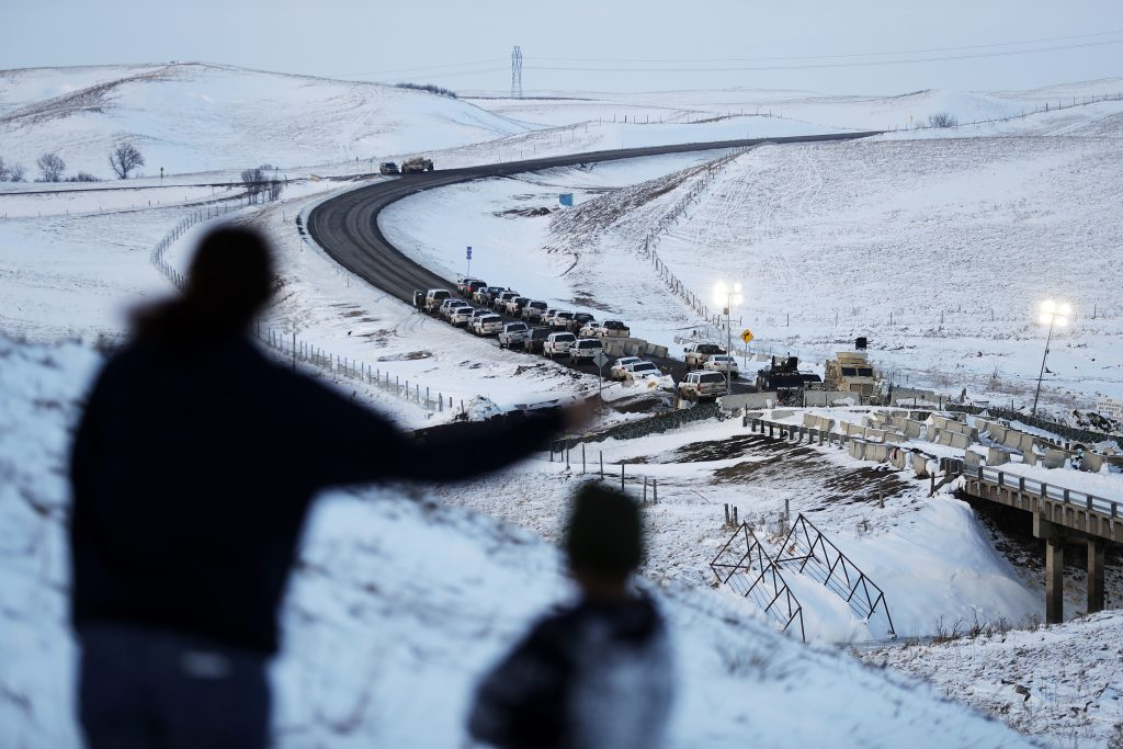 Law enforcement vehicles line a road leading to a blocked bridge next to the Oceti Sakowin camp where people have gathered to protest the Dakota Access oil pipeline in Cannon Ball, N.D. (AP Photo/David Goldman)