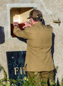 Cuba's President Raul Castro places the ashes of his older brother Fidel Castro into a niche in his tomb at the Santa Ifigenia cemetery in Santiago, Cuba, on Sunday. (Marcelino Vazquez Hernandez/Pool Photo via AP)