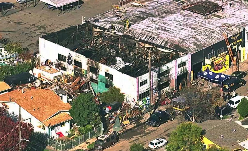 This Dec. 3, 2016 image from video provided by KGO-TV shows the Ghost Ship Warehouse after a fire that started late Friday swept through the Oakland, Calif., building. Dozens of people are confirmed dead with the toll expected to rise. (KGO-TV via AP)