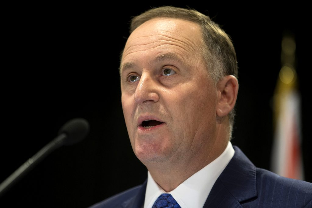 New Zealand Prime Minister John Key announces his decision to resign and stand-down from politics at a press conference in Wellington, New Zealand, Monday, Dec. 5, 2016. Key stunned the nation on Monday when he announced he was resigning after eight years as leader. (Mark Mitchell/New Zealand Herald via AP)